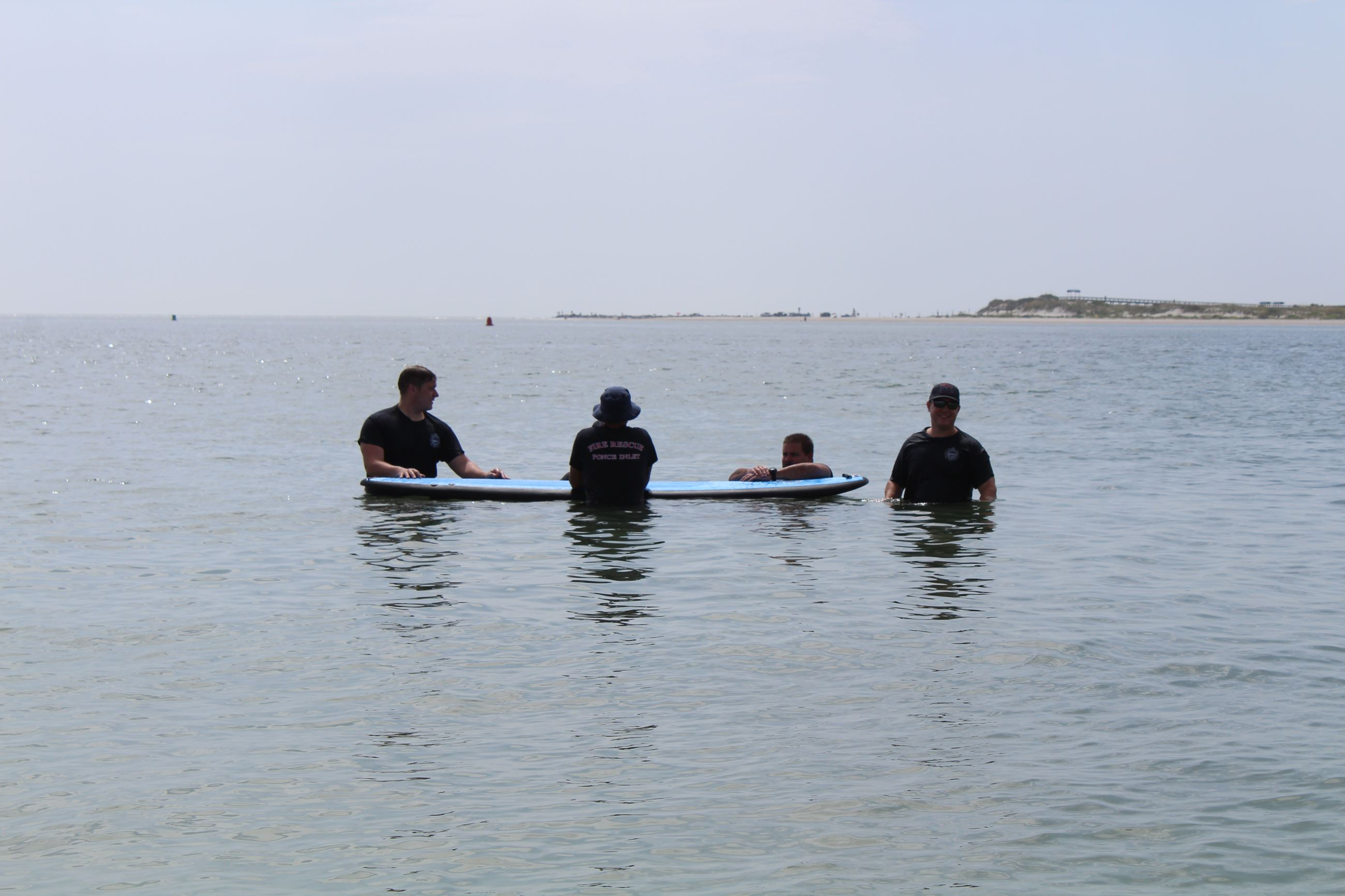 Firefighters in water with paddleboard (2)