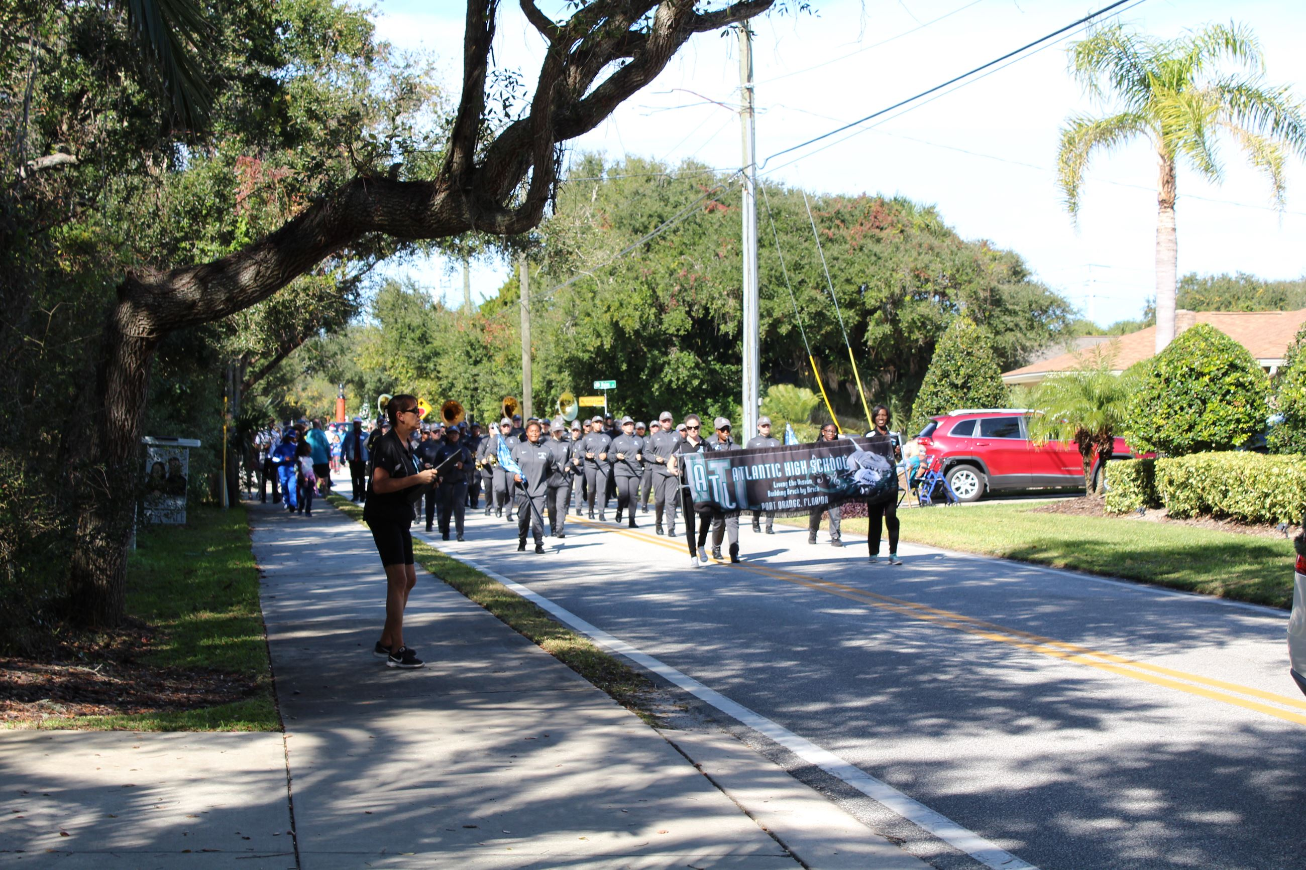 Atlantic high school band kids carrying banner